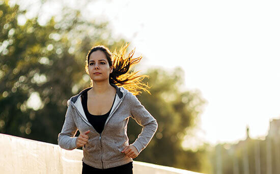 beautiful female jogging in city